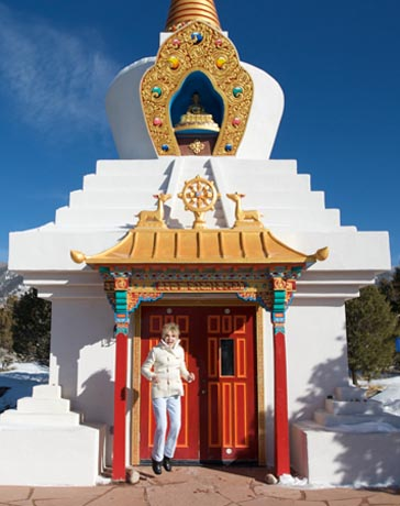 •	Ellen Wood, jumping with joy at Buddhist temple, NM